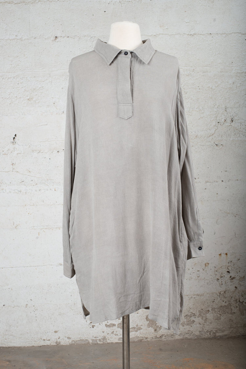 View of a secondhand garment with the neck buttoned up,