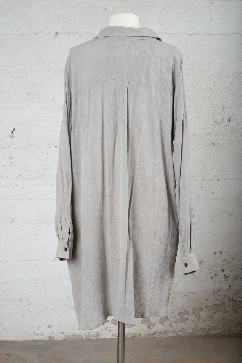 Back view of a secondhand garment with the sleeves down.