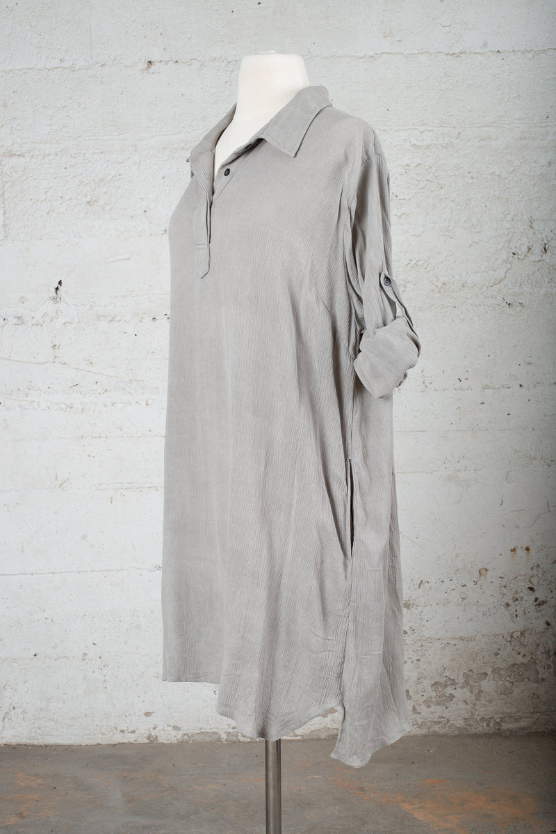 Front, angle view of a sustainable fashion secondhand garment with sleeves rolled up.