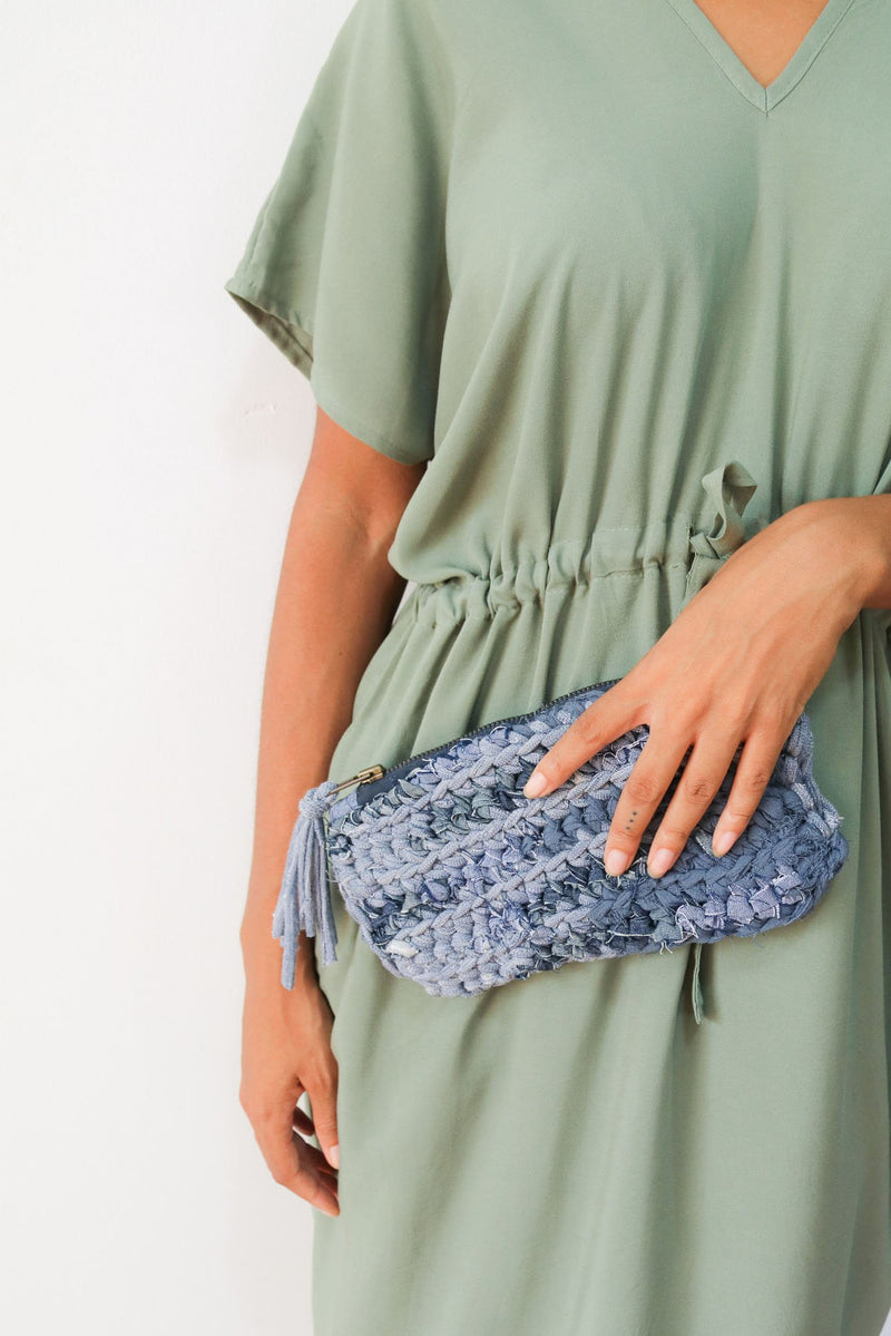 Add a fun zero waste accent to any look by carrying this crocheted clutch.