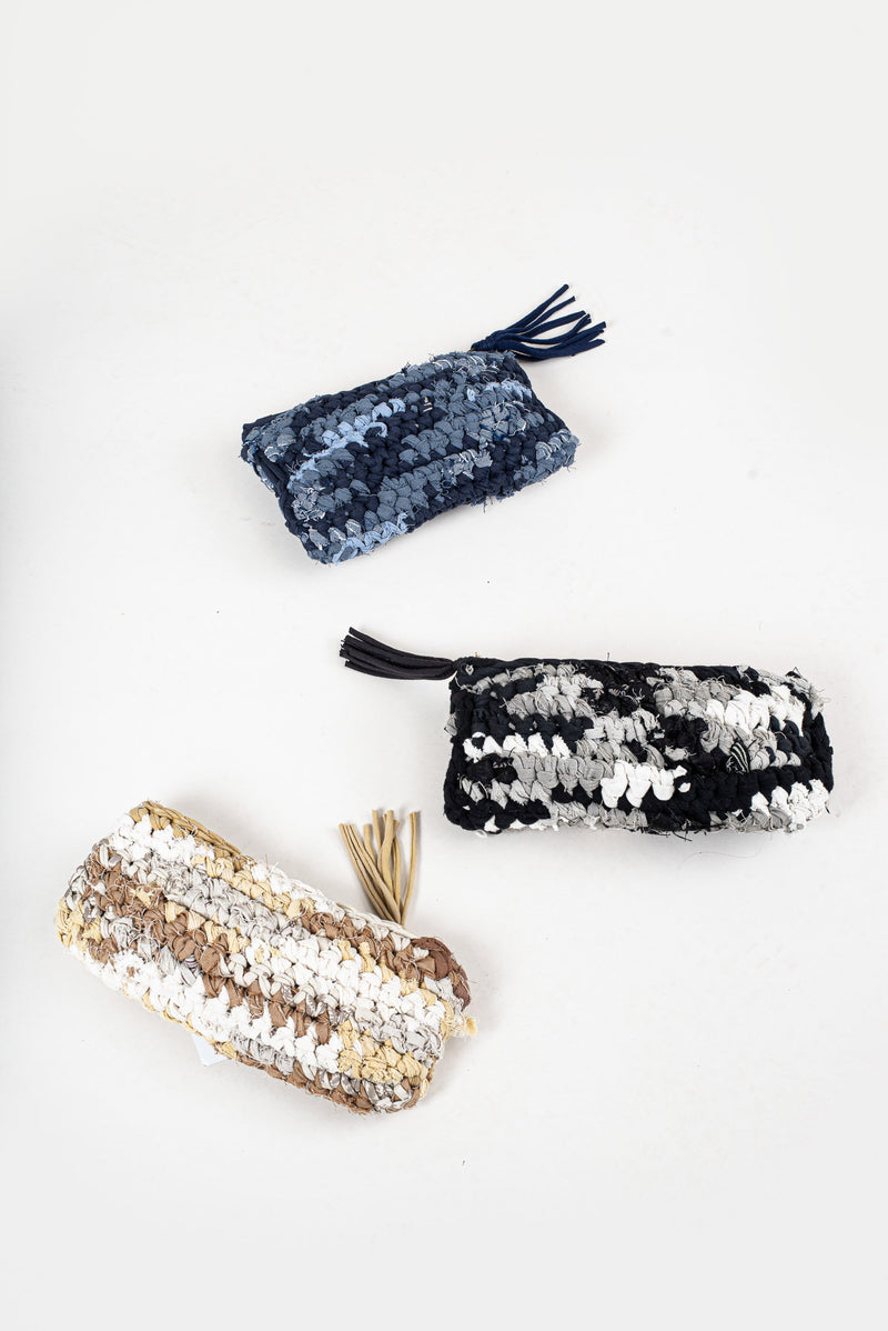 Our crocheted clutch is made from reclaimed textiles as part of a zero waste process.