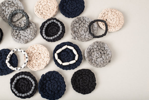 Ethically and sustainably made crocheted coasters can be resting places for drinks or accessories.