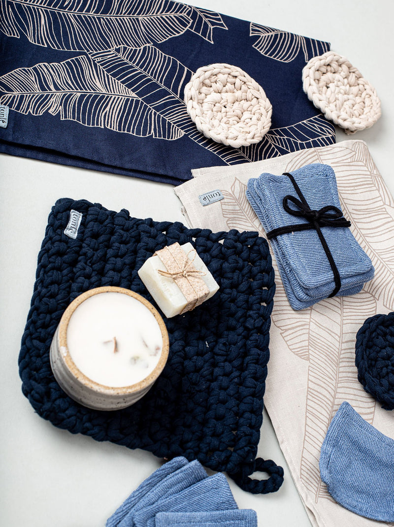 A shot of our crocheted potholder in navy with other pieces for your zero waste home.