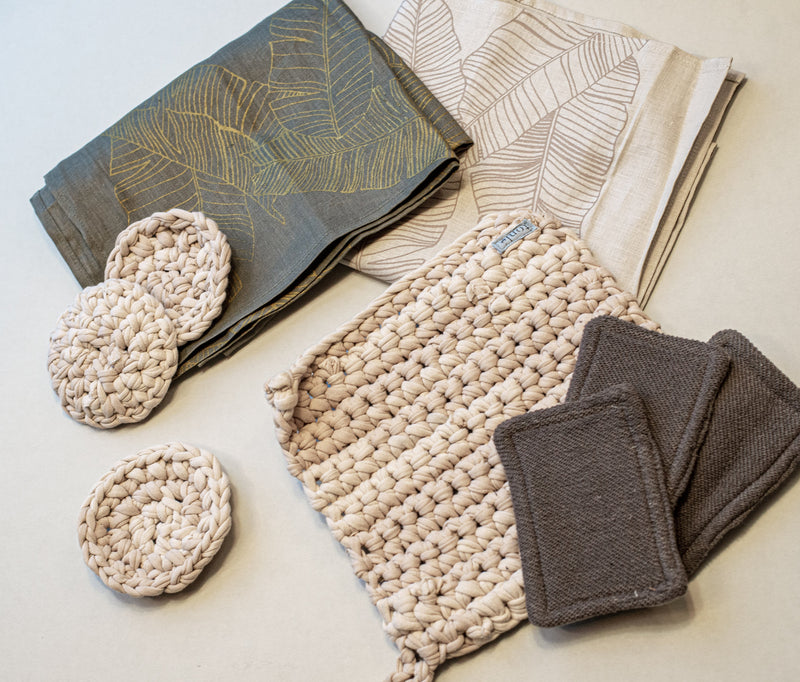A view of our crocheted potholder in palm with other ethically made homewares.