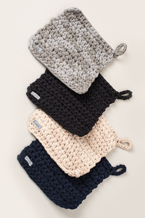 Our crocheted potholder is sustainably made from reclaimed jersey scraps.