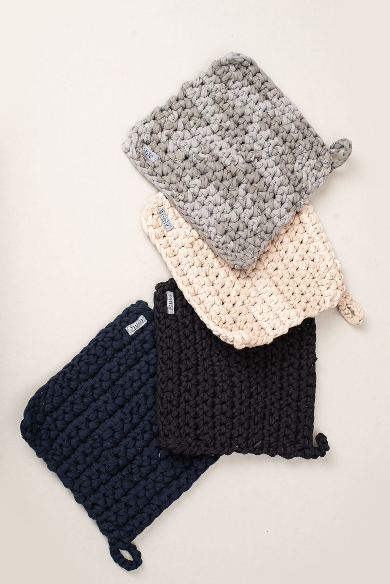 Our crocheted potholders come in four different colors, each one is seen here.