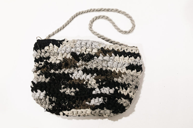 Our crocheted purse in black, grey and gold. The circular fashion bag can hold all your essentials.