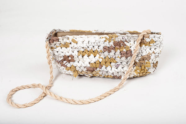 Our crocheted purse is handmade from reclaimed textiles in our unique zero waste process.