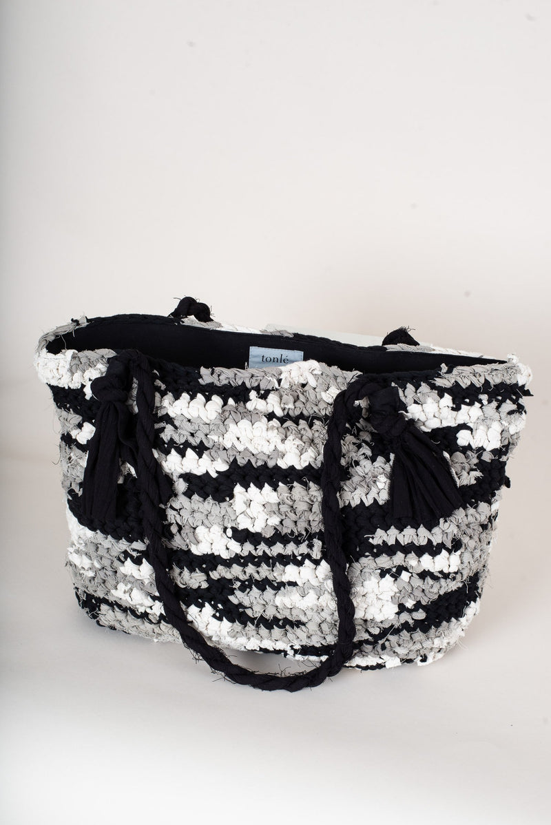 An upright image of our fair fashion crocheted tote in black, grey and gold.