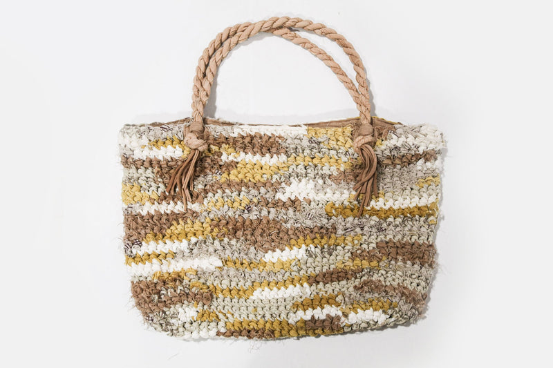 A flat view of our sustainably made crocheted tote in mustard and neutrals.