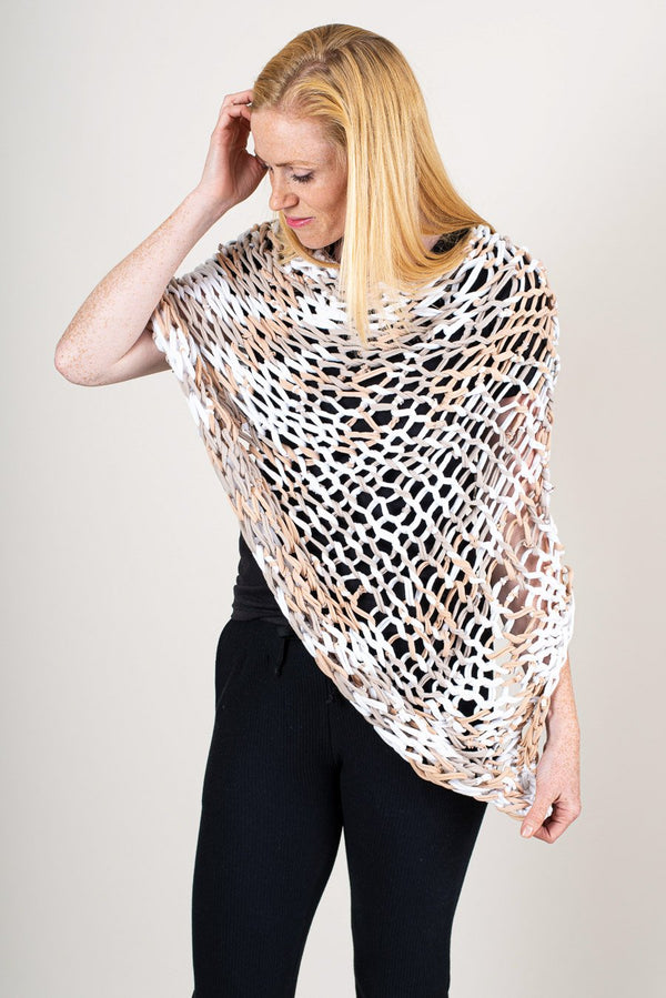 This sustainably made Maleng poncho is one of out most popular accessories. Seen here in natural.