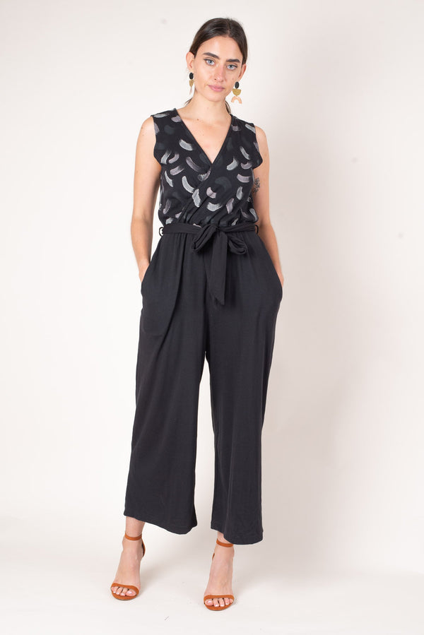 A front view of our hand painted mandy jumpsuit in reclaimed black jersey.