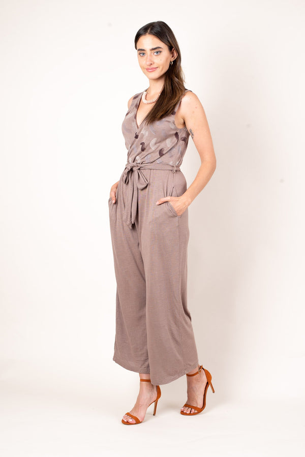 A slightly angled view of our taupe zero waste jumpsuit in soft reclaimed cotton jersey. This jumpsuit features pockets and an elegant wrap waist.