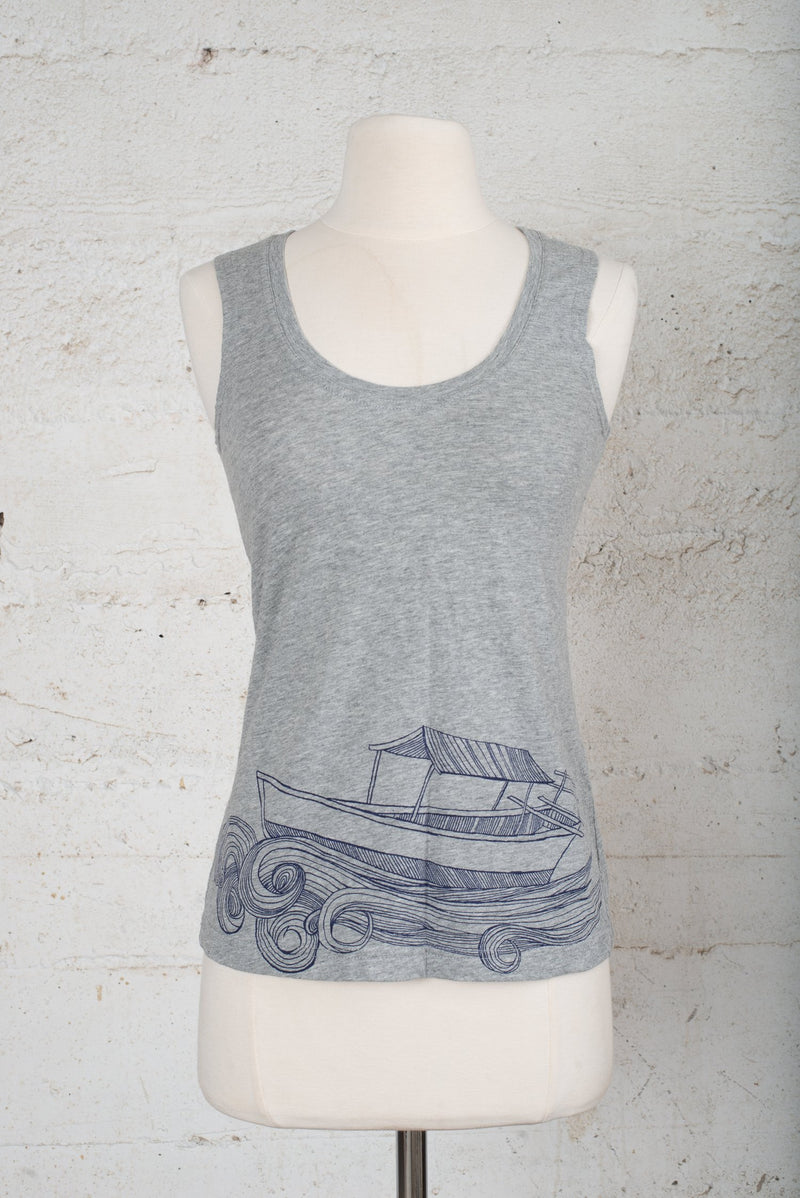 A front view of a tank top with a handprinted design for sale on our circular fashion platform.