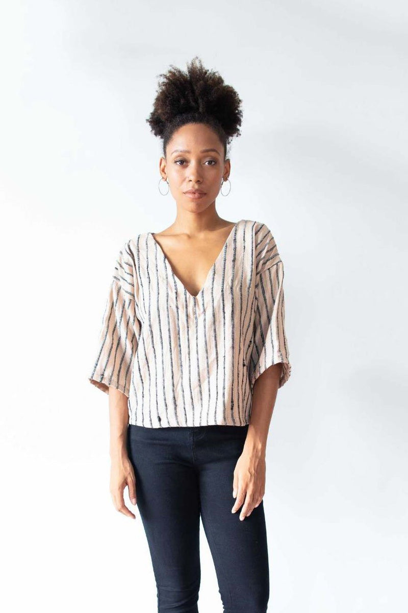 Out sustainably made Veha top can be paired with jeans, as the palm and black top is styled here, or with tailored trousers.