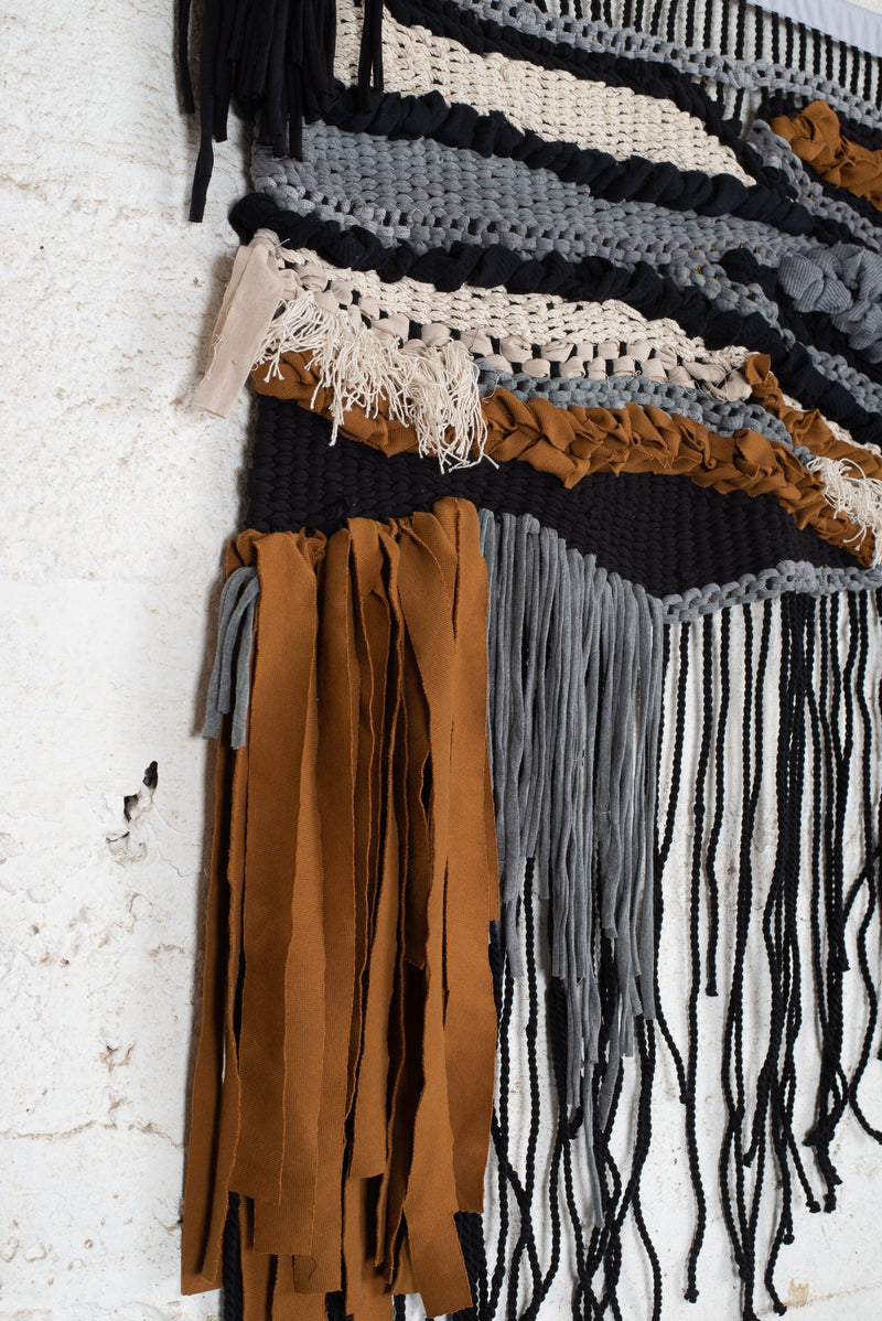 This detail shot of our ethically made wall hanging shows the texture of the reclaimed textiles.