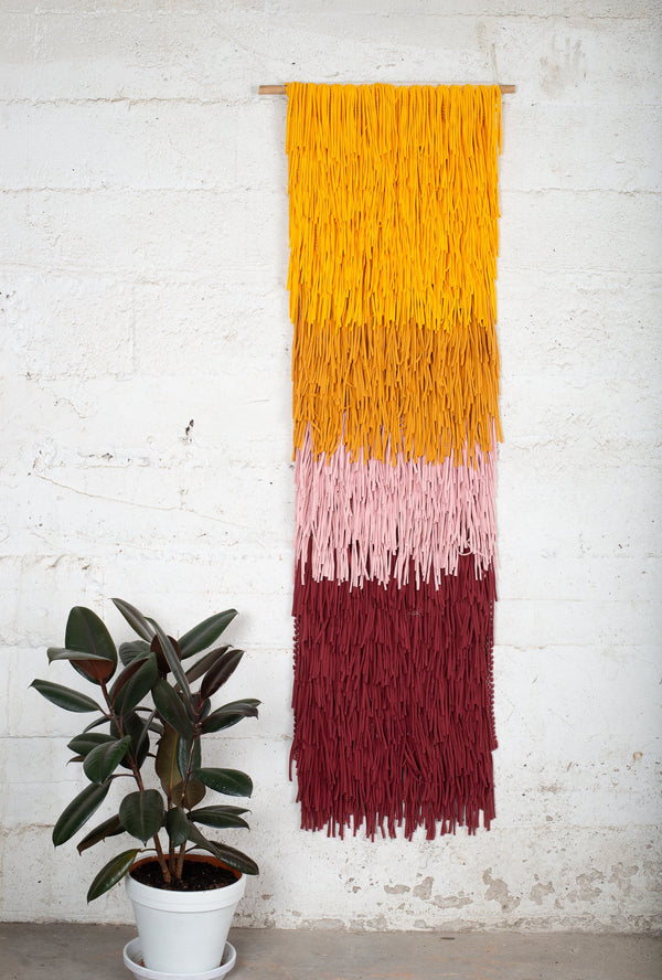 Adorn the walls of your zero waste home with this ethically and sustainably made wall hanging with a bold stripe design.