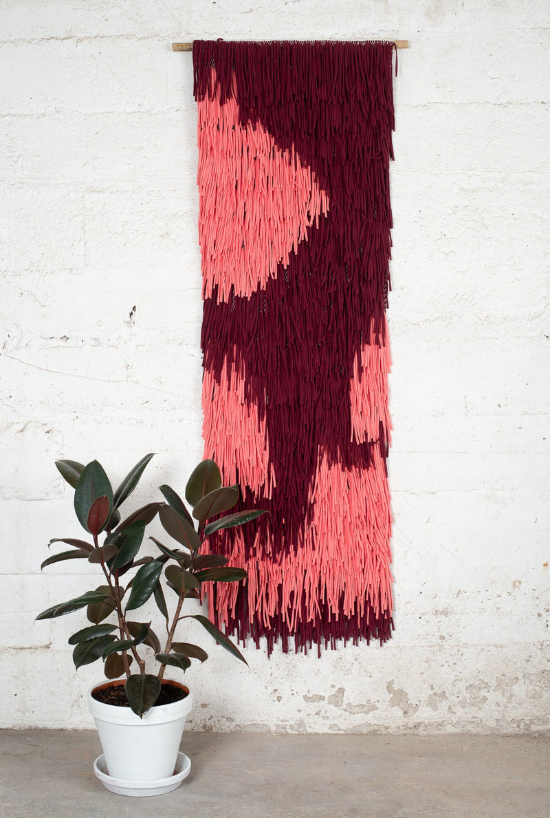 A handwoven wall hanging made from reclaimed textiles for your zero waste home.