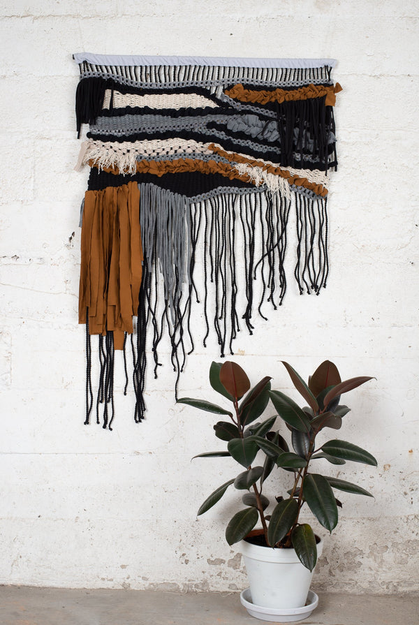 This handwoven wall hanging is made from reclaimed fabric scraps in our zero waste process.