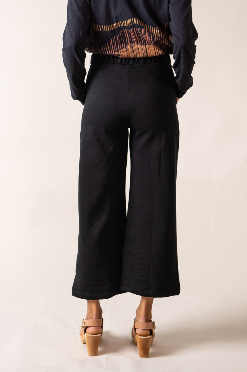 This back view of our sustainable fashion Jorani pants shows the cut of the wide leg.