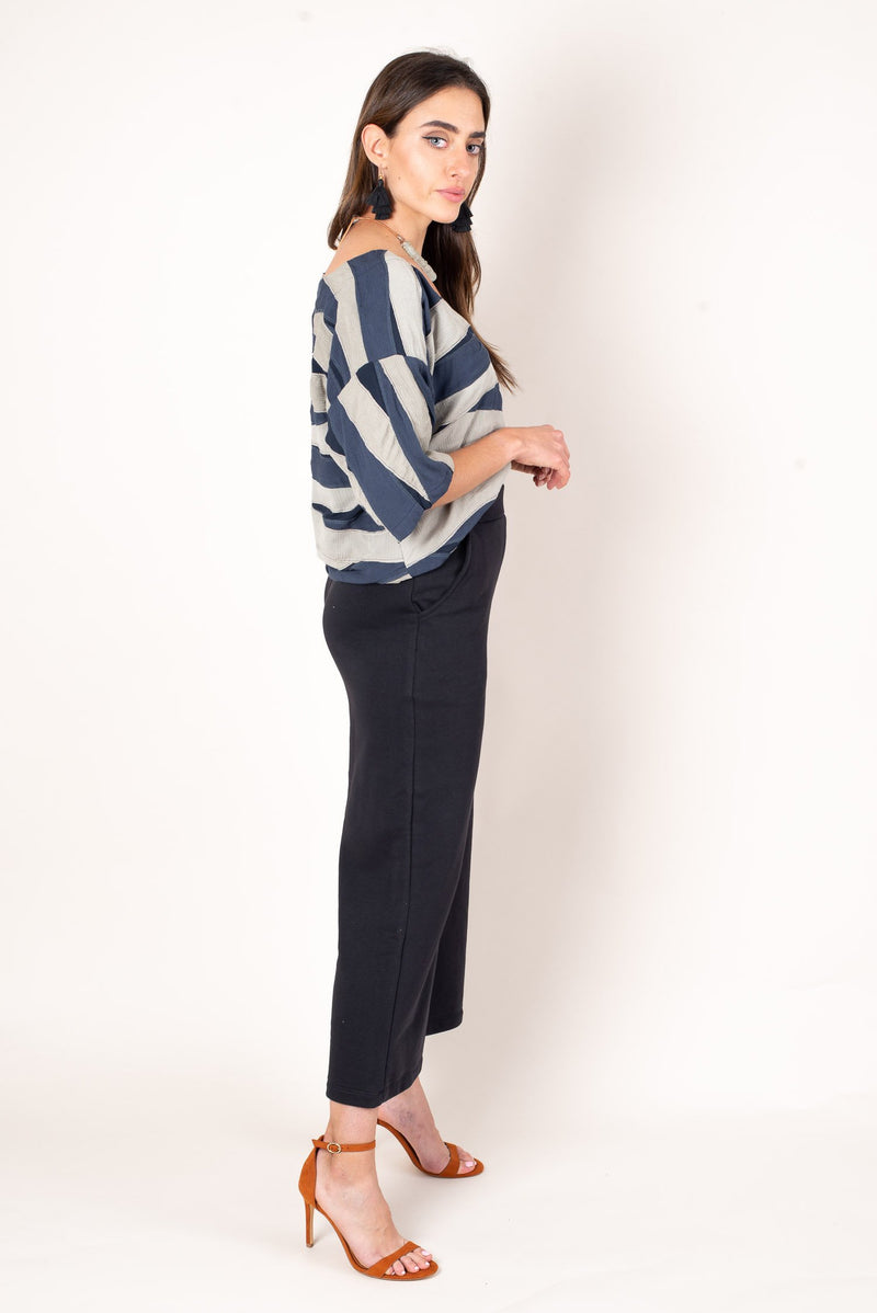 A side view shows off the high waisted fit of our chic jorani sweatpants with deep pockets.