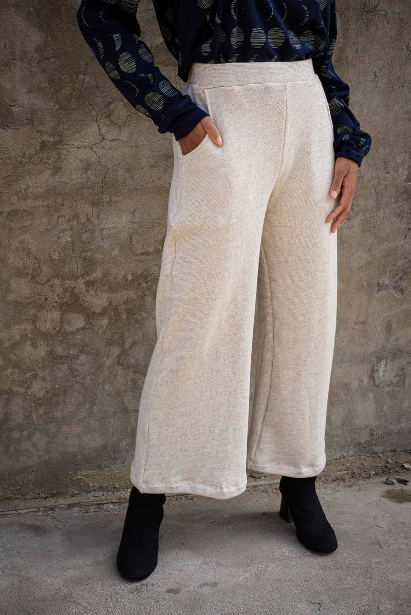 The Jorani pants, seen here in cream, are essentials for the minimalist capsule wardrobe.