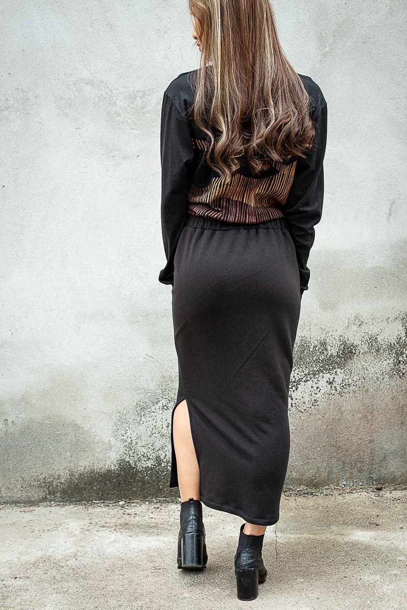 This back view of our sustainably made Jorani skirt shows the length of the hem and the easygoing elastic waistband.