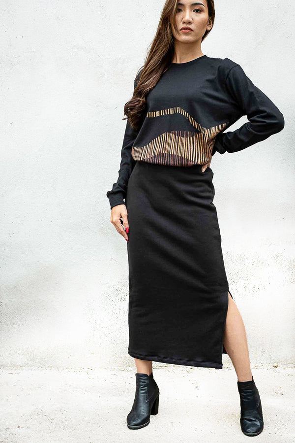 This image of our Jorani skirt in black shows the side slit that makes movement easy.
