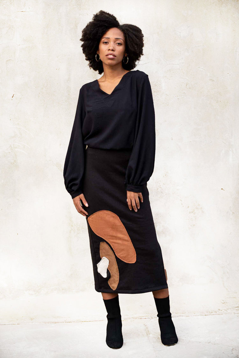 This version of our Jorani skirt has a bold graphic applique pattern. Seen here in black.