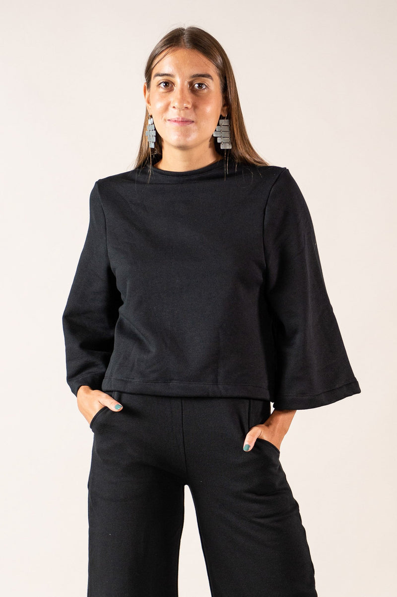 Our sustainably made Jorani sweatshirt is seen here in black.