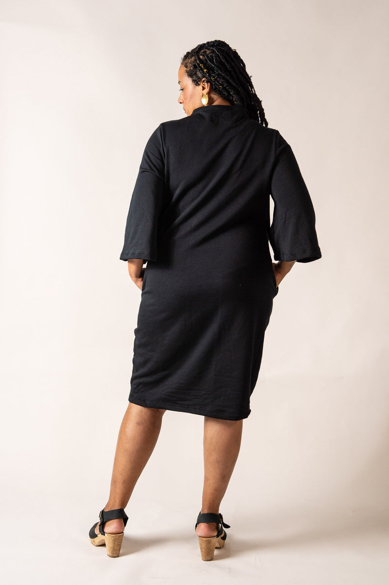 This back view of our fair fashion Jorani dress in black shows the drape of the garment.