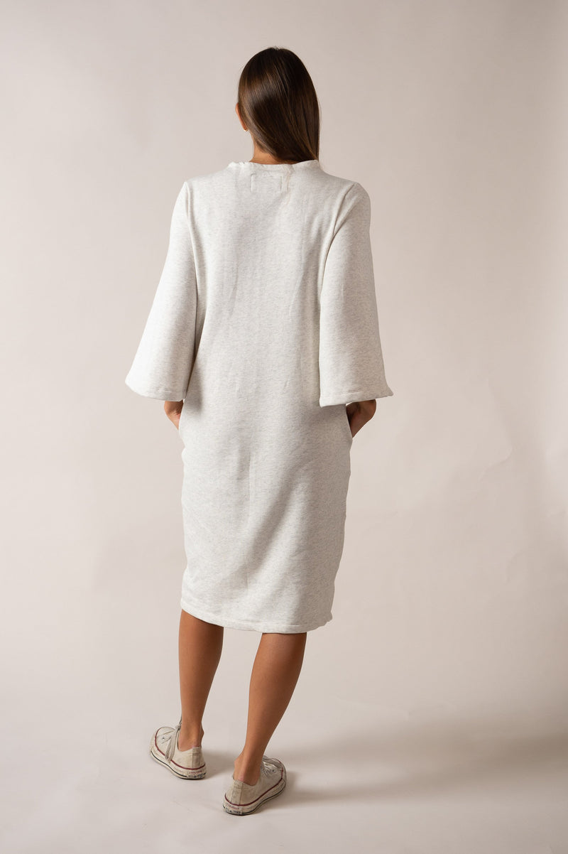 This back view of our circular fashion Jorani dress in cream shows the length of the hem.