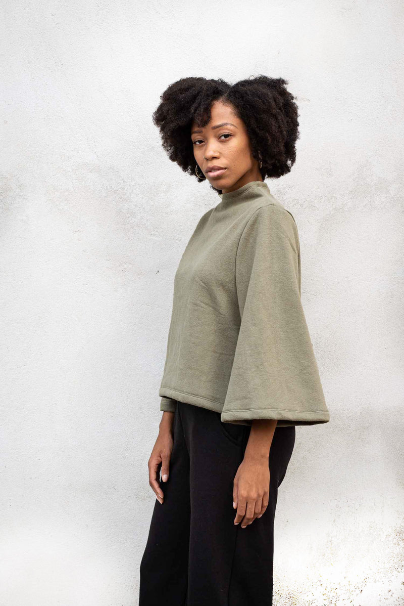 This image shows the wide cut, cropped sleeve on our fair fashion Jorani sweatshirt.