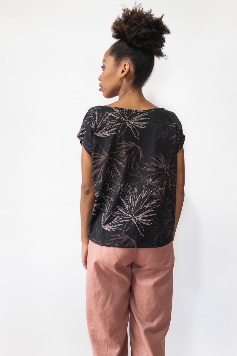 A back view of the Keang top in black with our cactus print that shows the boxy cut.