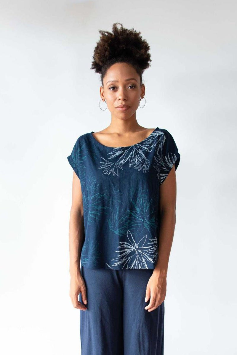A front view of our ethically made Keang top in navy with a cactus print.