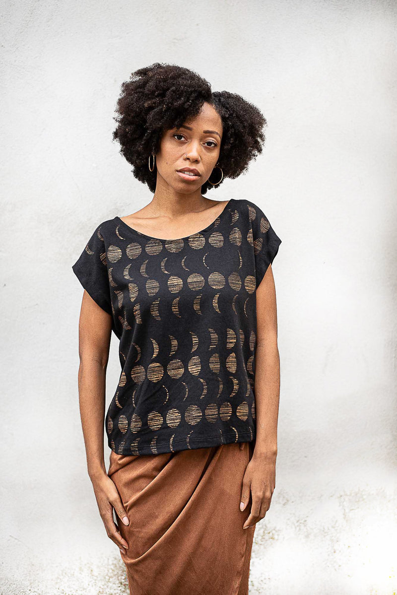 Our fair fashion Keang top with a moon cycle print can be paired with your favorite skirt or pair of pants.