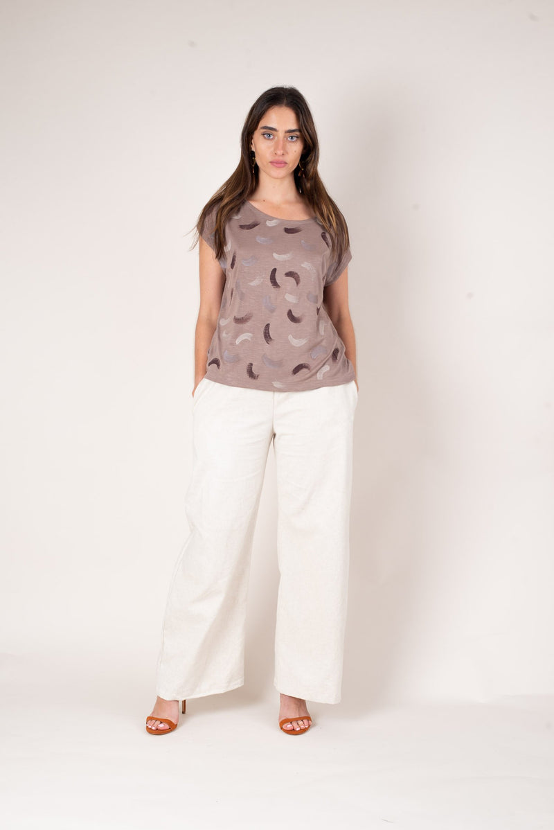 A full body look at the taupe colored keang top perfectly paired with trousers. This top is a perfected sustainable fashion pieces made with our unique zero waste process.