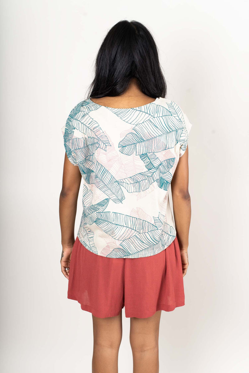 A back view of the Keang top in cream with our banana palm print that shows the length untucked.
