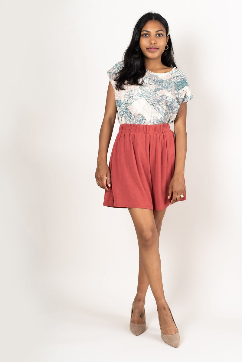 Our sustainably made, hand-printed Keang top seen styled with high-waisted shorts.