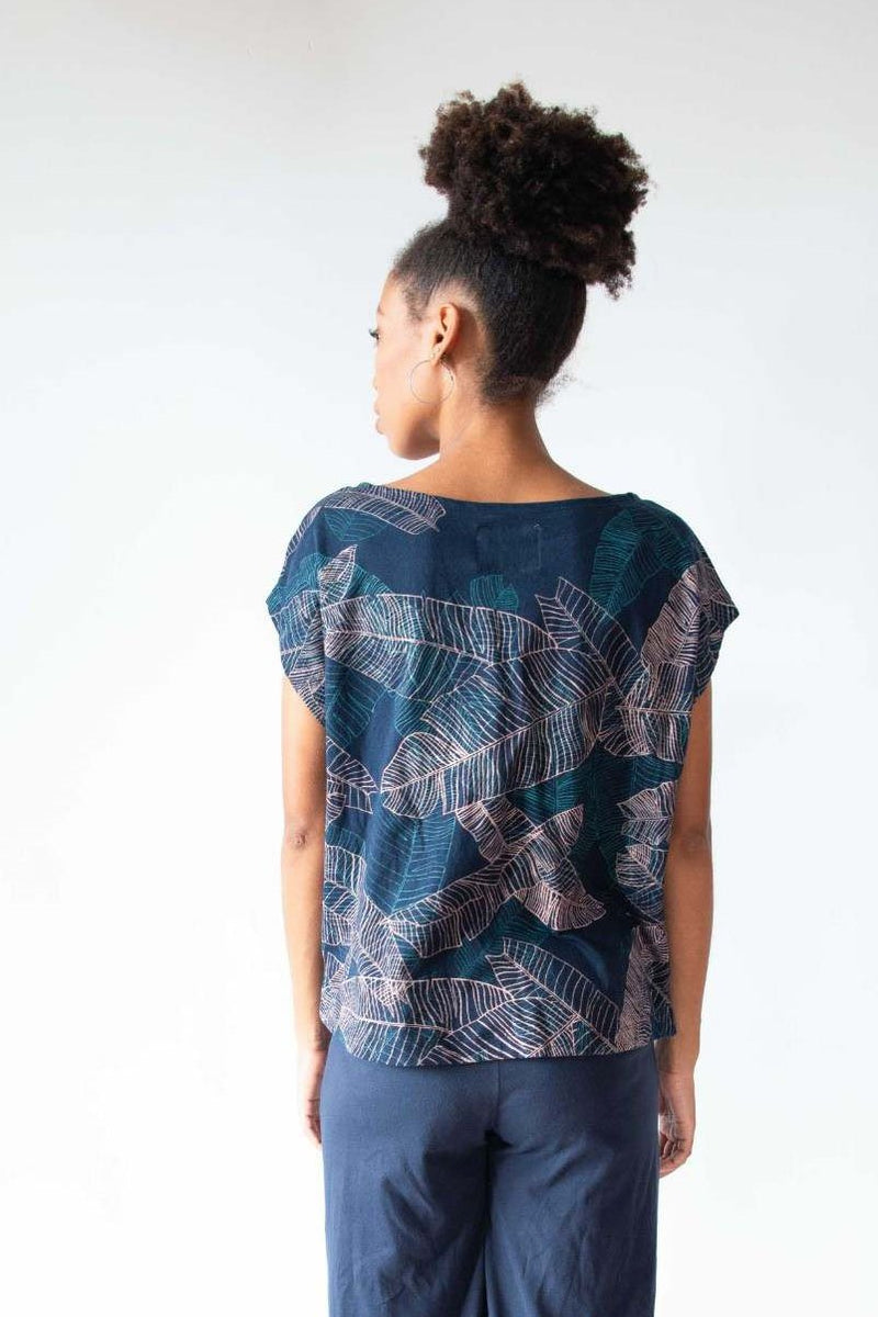 A back view of the Keang top in navy with our banana palm print that shows the boxy cut.