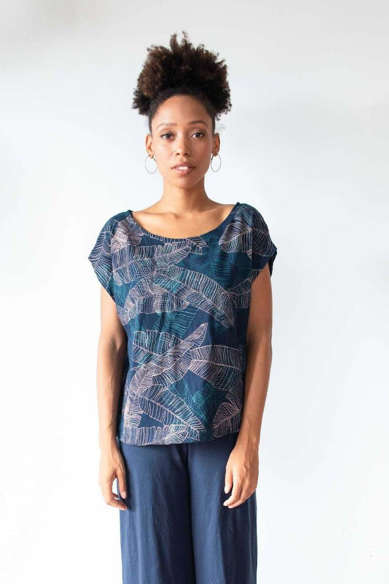 A front view of our ethically made Keang top in navy with a banana palm print.