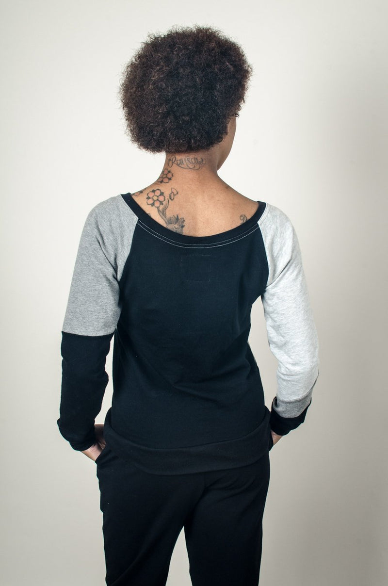 A back view of the Kendal sweatshirt in black, showing the colorblock pattern on the sleeves.