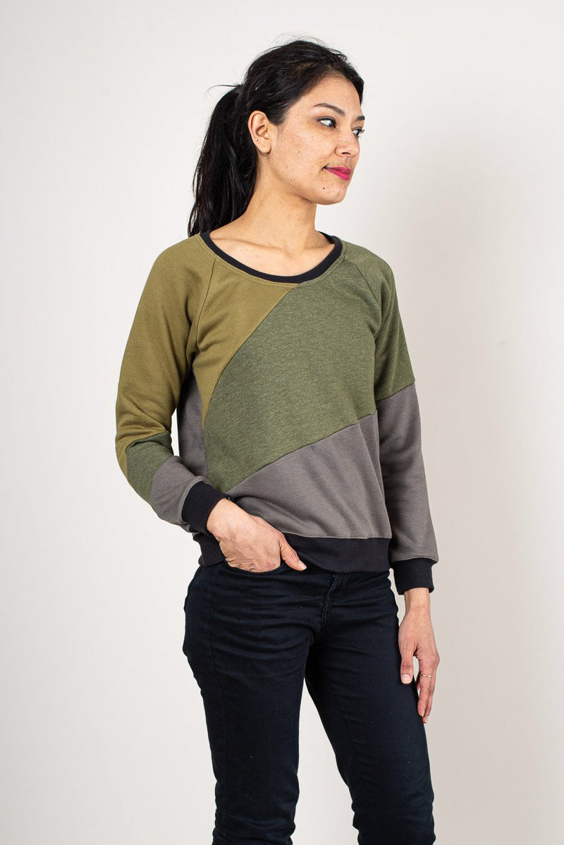 The colorblock design on the Kendal sweatshirt is made from remnant textiles in our unique zero waste process. Seen here in olive.