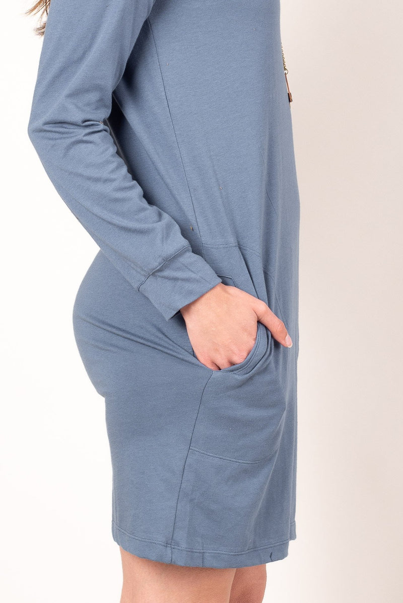 A close up view of the pockets and long sleeve of our incredibly comfortable khema dress, a sustainable fashion staple for any capsule wardrobe.
