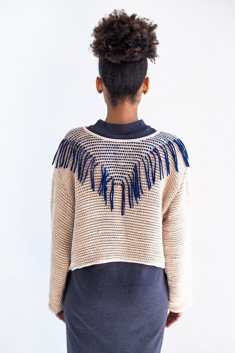 A back view of the Kiri sweater in palm and navy. This handwoven sweater is made in our ethical fashion workshop.