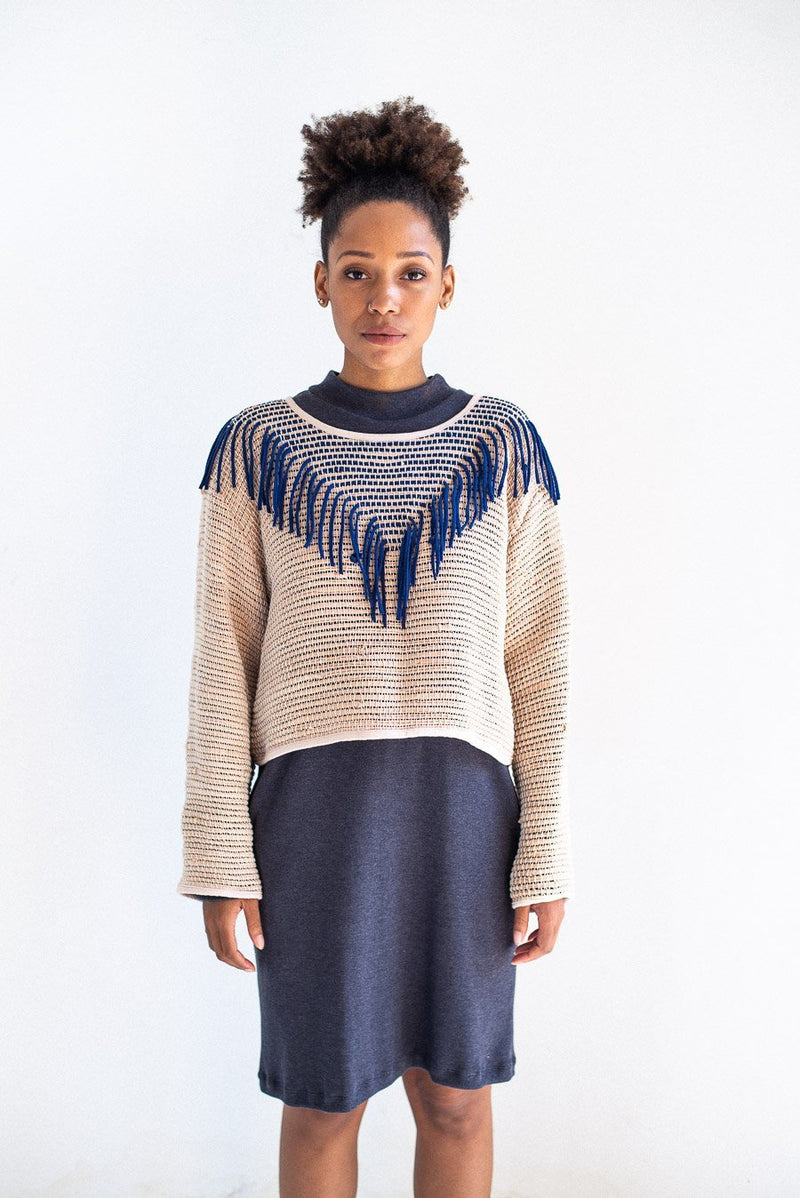 The Kiri sweater in palm and navy. This handwoven sweater is made in our circular fashion process.