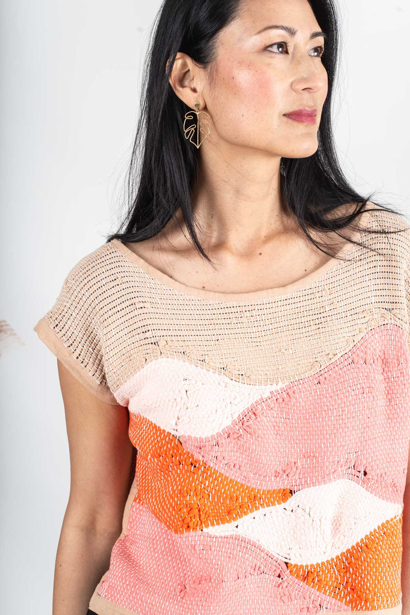 A detail of the landscape crop top in mesa that shows the intricate texture of the handwoven design.