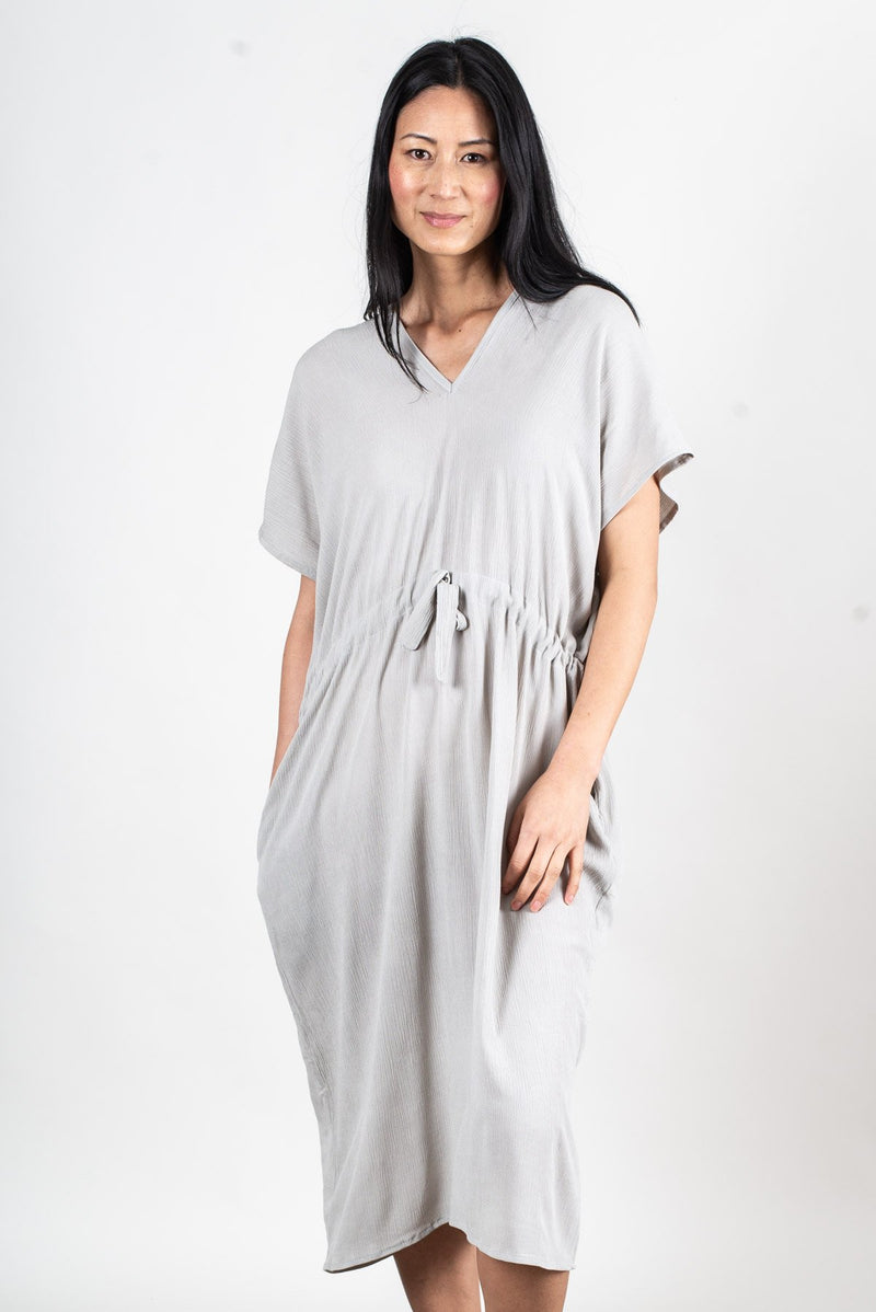 The drawstring waist on our kaftan, seen here in grey, makes for an easy fit.