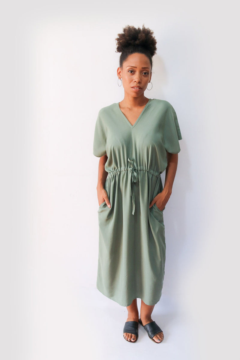 Our ethically made kaftan, seen here in sage, can be casually styled with slides or flats for a go-to day look.