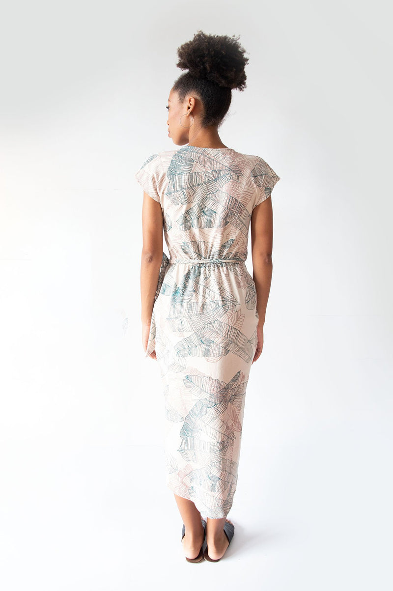 A rear view view of the lotus dress in cream with our banana palm print that shows the length of the dress in the back.